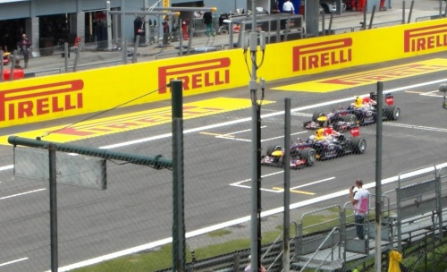 Red Bull, one & two approaching the starting grid.