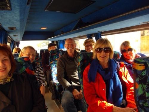 Sandra, June (peeking over the seat), Debra, Jim, Geri (peeking from behind Jim), myself, Jan and Judi on the bus