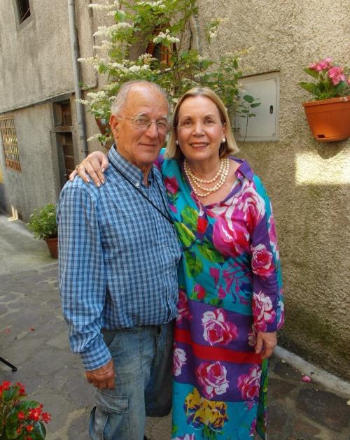 Rafael & Maria outside their house